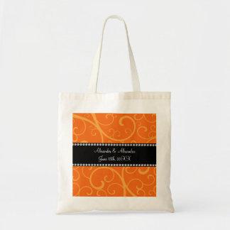 El naranja remolina los favores del boda bolsa tela barata