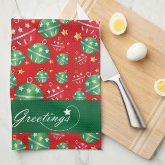 El navidad adorna en un fondo rojo toallas de cocina