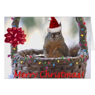 El navidad atesora en cesta con nieve tarjeta de felicitación