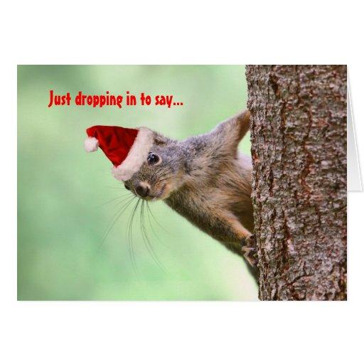 El navidad atesora en un árbol tarjetón
