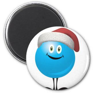 El navidad azul adorna llevar un gorra rojo de san imán