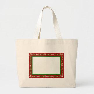 El navidad confina los copos de nieve rojos de la  bolsa