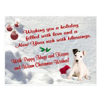 El navidad de Jack Russell abraza y besa la postal