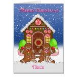 El navidad de la casa de pan de jengibre y de la felicitación
