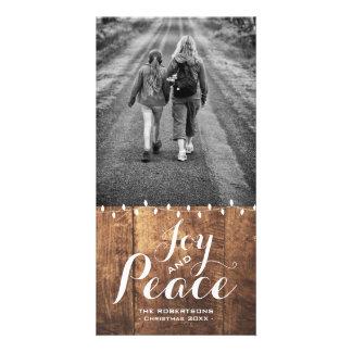 El navidad de la paz de la alegría desea las luces tarjetas fotograficas