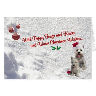 El navidad de Westie abraza y besa la tarjeta de f