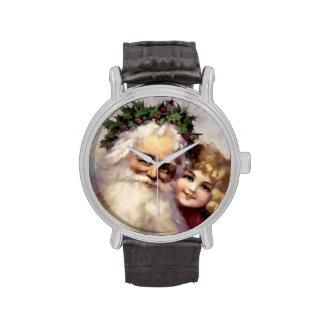 El navidad mira con Santa y el niño Reloj