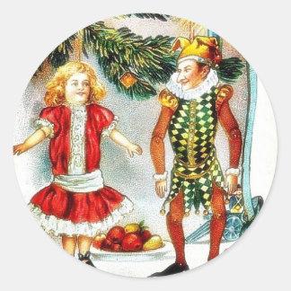 El navidad que saluda con un chica baila con un etiquetas redondas