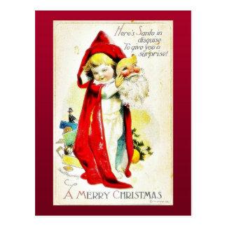 El navidad que saluda con un chica lleva a cabo la tarjetas postales