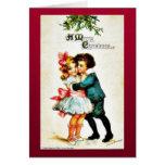 El navidad que saluda con un muchacho abraza a un  tarjeta