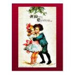 El navidad que saluda con un muchacho abraza a un  tarjetas postales