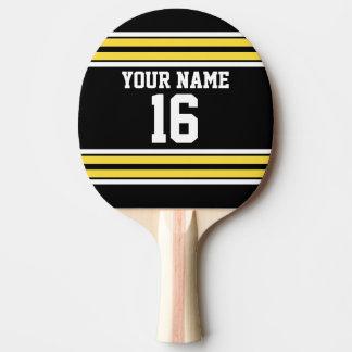 El negro con blanco amarillo raya el jersey de pala de tenis de mesa