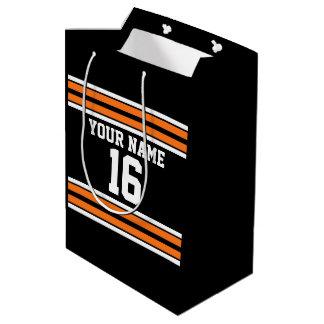 El negro con blanco anaranjado raya el jersey de bolsa de regalo mediana