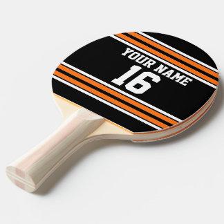 El negro con blanco anaranjado raya el jersey de pala de ping pong