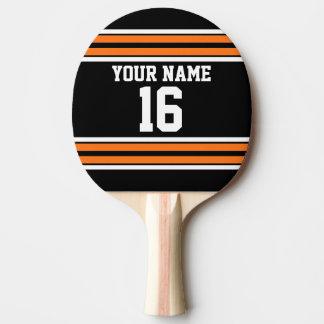 El negro con blanco anaranjado raya el jersey de pala de tenis de mesa