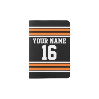 El negro con blanco anaranjado raya el jersey de porta pasaportes