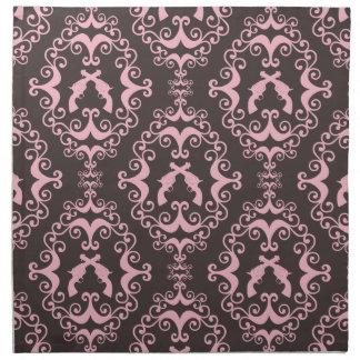 El negro rosado del damasco dispara contra las pis servilleta imprimida