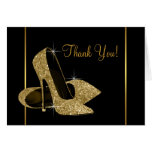 El negro y el zapato del tacón alto del oro le agr