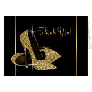 El negro y el zapato del tacón alto del oro le agr tarjeta