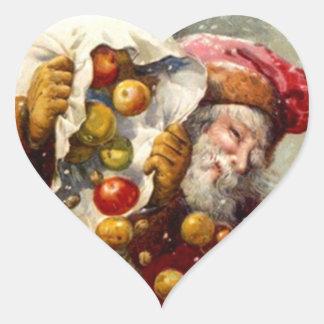 El nevar del saco de las manzanas de Santa del Pegatina De Corazon