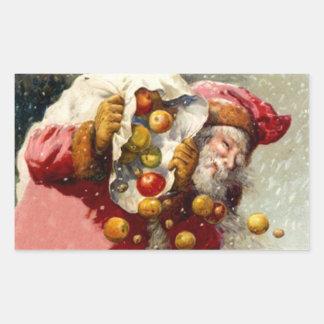 El nevar del saco de las manzanas de Santa del Rectangular Pegatinas