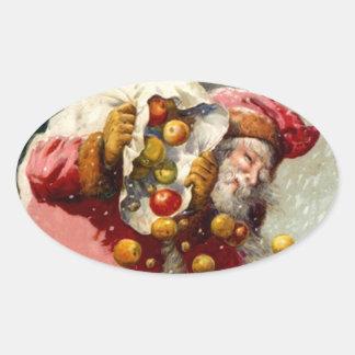 El nevar del saco de las manzanas de Santa del Pegatinas De Oval