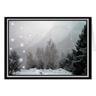 El nevar en la tarjeta de felicitación del navidad