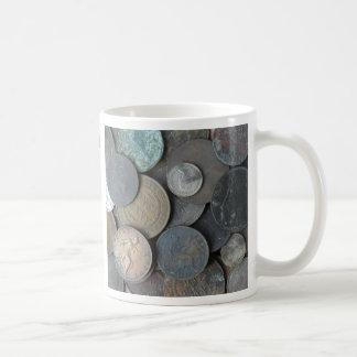 El ney viejo acuña principalmente peniques taza de café