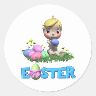 El niño celebra su primera Pascua Etiqueta Redonda