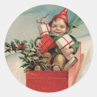 El niño del navidad del vintage presenta a los pegatina redonda