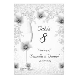 El número de la tabla del boda florece los rosas d comunicado personal