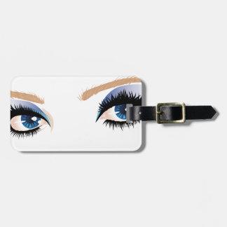 El ojo compone etiquetas de maletas