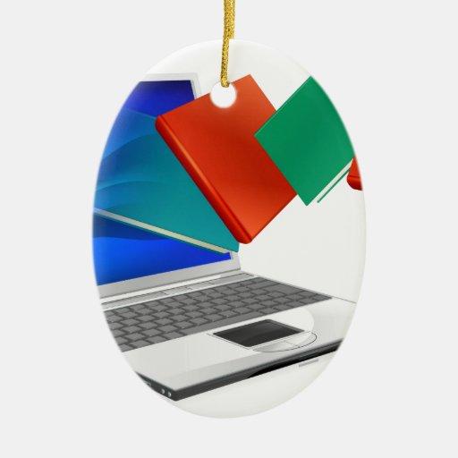 El ordenador portátil reserva la educación o el adorno navideño ovalado de cerámica