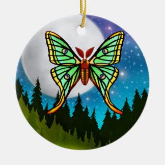 El ornamento español de la polilla de la luna adorno navideño redondo de cerámica