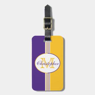 El oro blanco púrpura raya el monograma etiquetas maletas