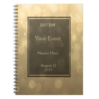El oro Bokeh enciende el libro de visitas Cuaderno