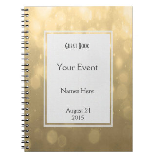 El oro Bokeh enciende el libro de visitas Spiral Notebook