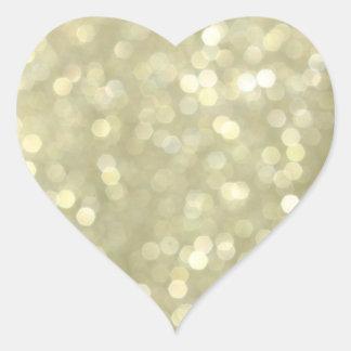 El oro chispea pegatina del corazón
