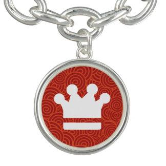 El oro corona el icono pulsera con dije