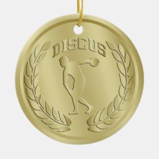 El oro del lanzador de disco entonó el ornamento adorno navideño redondo de cerámica