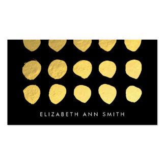 El oro elegante puntea la tarjeta de visita negra