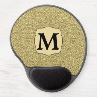 El oro graba en relieve el monograma de la impresi alfombrillas con gel