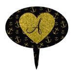 El oro negro del monograma ancla el modelo figuras para tartas