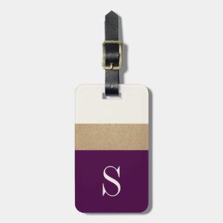 El oro púrpura del monograma moderno rayó la etiquetas para equipaje