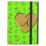 El oro verde de neón del monograma ancla el corazó