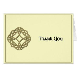 El oro y la marfil célticos del nudo de la tarjeta de felicitación