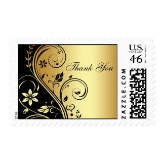 El oro y la voluta floral del negro le agradecen f