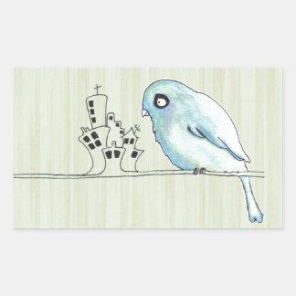 el pájaro azul de la acuarela se encaramó en una pegatina rectangular