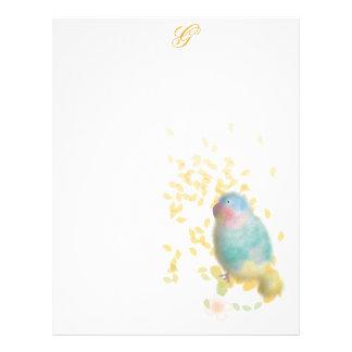 El pájaro con oro sale del papel con membrete membrete