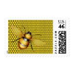 El panal amarillo negro manosea sellos de la abeja